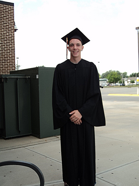 Markie in his gown outside the high school before graduating with his summer school class.